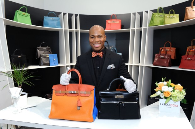 Salesman and vintage handbag enthusiast, Tinor, with an Hermes Birkin and an Hermes Kelly bag. Photo courtesy of Getty.