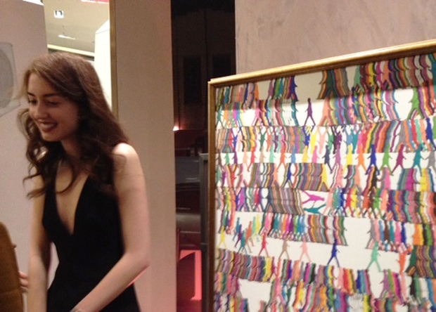 Isabella Huffington stands beside one of her kaleidoscopic works.