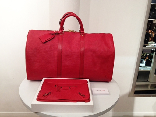 Cherry Red Louis Vuitton Epi Leather Duffel and Balenciaga clutch.