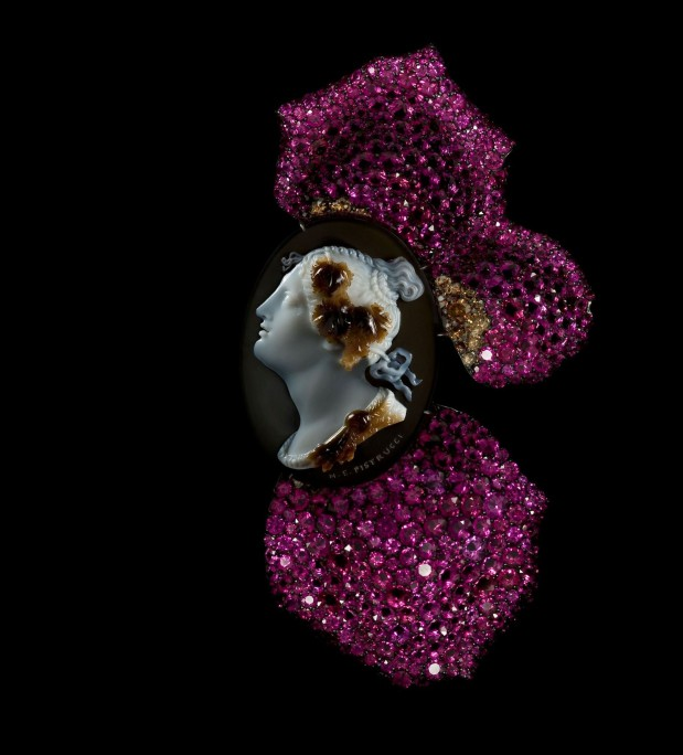 JAR Cameo and Rose Petal Brooch, 2011. Made of rubies, diamonds, silver, and gold. Courtesy of JAR, Paris.